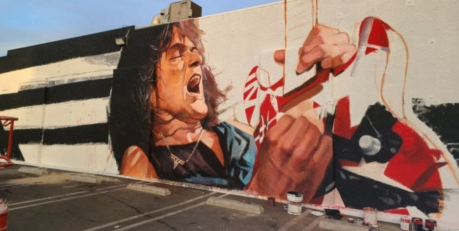 """Eddie Van Halen Mural Launched, Celebrating Guitar Virtuoso Birthday""<br /><br />""Celebrating Eddie Van Halen's birthday today, Tuesday, January 26, an artist from Los Angeles, Robert Vargas created a mural dedicated to his idol.<br />""Long Live The King"" is the title of the mural art created by Robert Vargas. During the process of making the mural, Vargas listened to all of Van Halen's music.<br /><br />Eddie Van Halen was supposed to celebrate his 66th birthday. However, he passed away in October last year."""