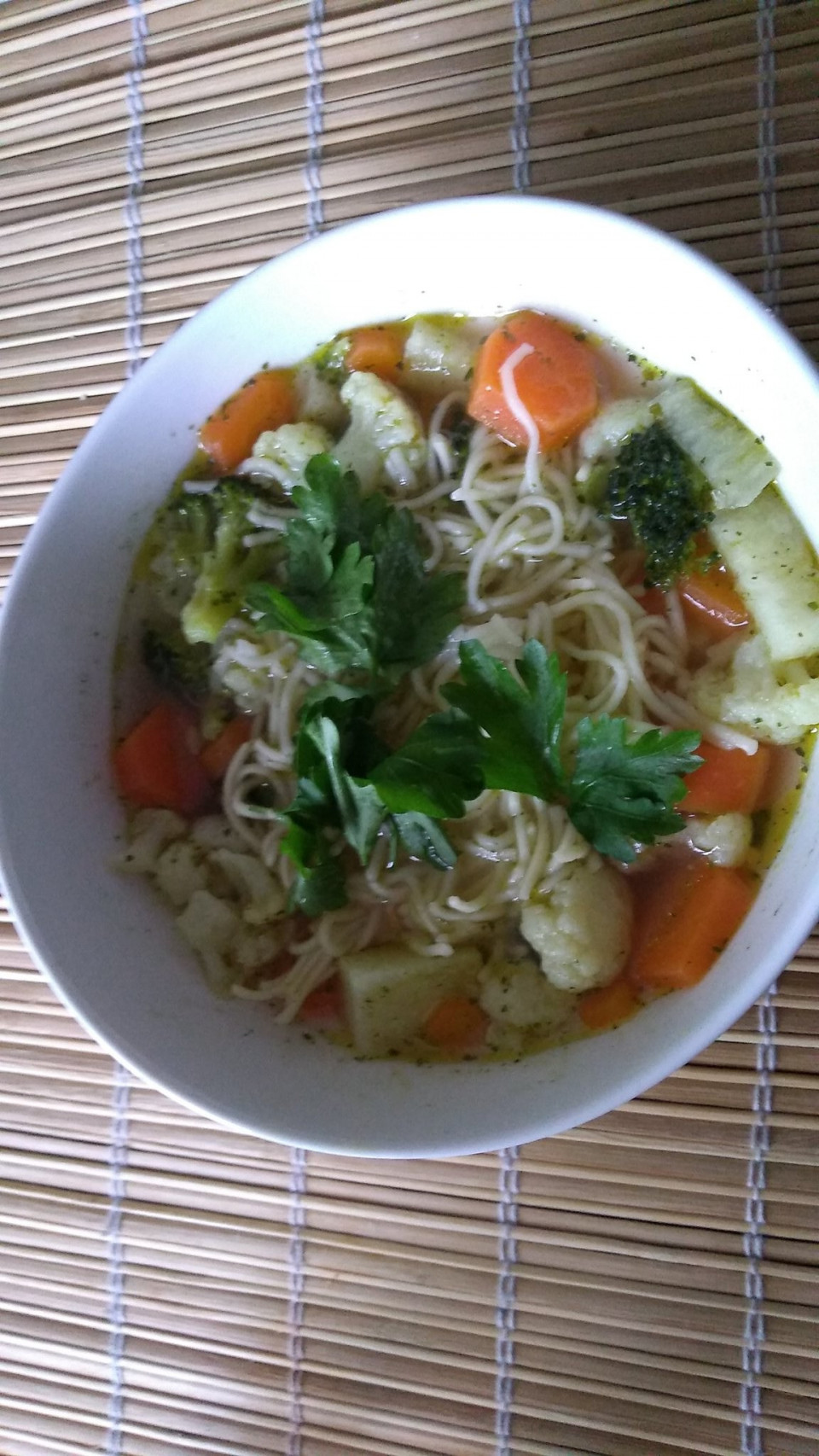 Fresh home made vegetables soup with cauliflower, carrots, kohlrabi, broccoli and noodles