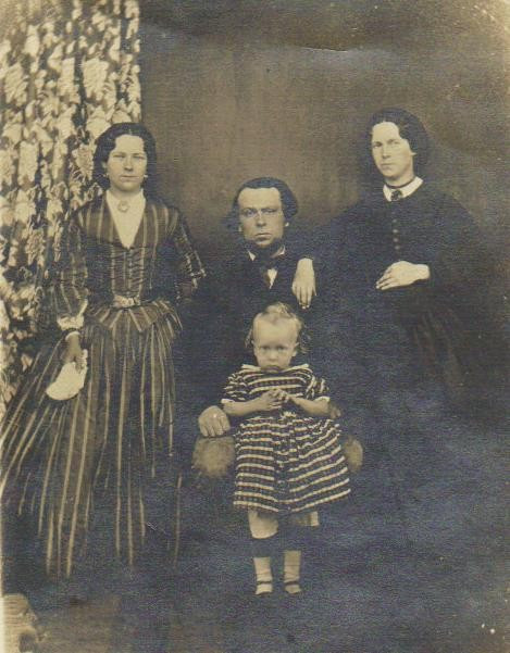 Wickford, Essex - 1863.John Carter (sitting) and Anna Carter (nee Murray, with her hand on his shoulder) are my Great Great Grandparents.  The female on on the left is one of Anna's sisters.  At the front is Frank Carter (1860-1940).Anna is expecting their second child, born in January 1864.